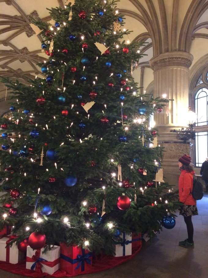 Michelle looking at the giant Christmas Tree in the Town Hall that has Hamburg-related ornaments