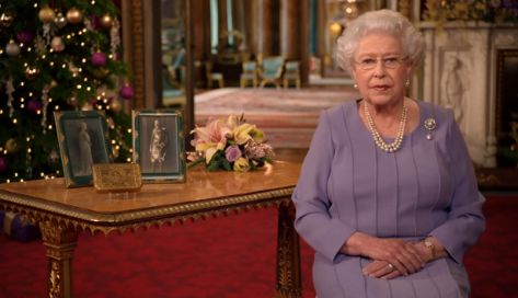 Behind the Queen, the Christmas Tree, a non-secular symbol